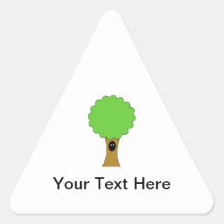 Green tree cartoon with creature. triangle sticker