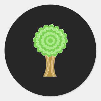 Green Tree. On black background. Round Sticker