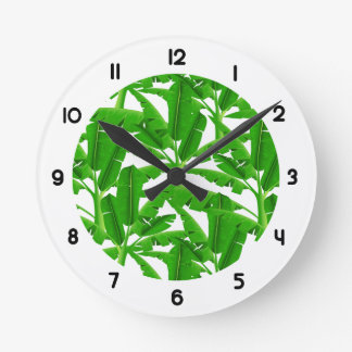 Green tropical palm trees round clock