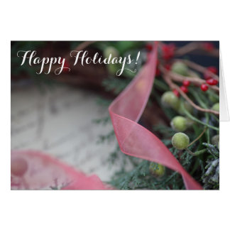 Green wreath with berries, ribbon greeting card