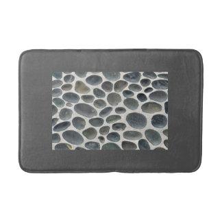 Grey bathmat with pebble patterned inset bath mats
