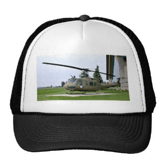 Grey Helicopter in green landscape Hats