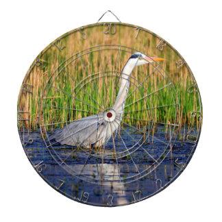 Grey heron, ardea cinerea, in a pond dartboard