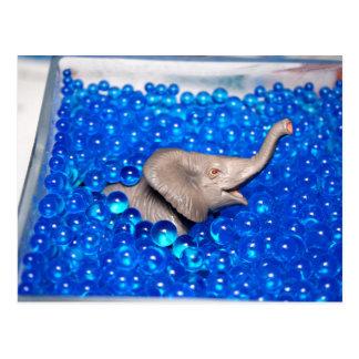 grey plastic elephant in blue balls postcard