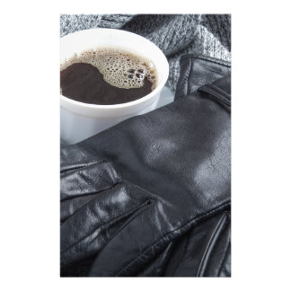 Grey wool scarf and leather gloves stationery