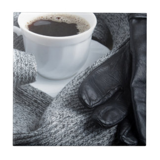 Grey wool scarf and leather gloves tile