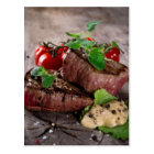 Grilled bbq steaks with fresh herbs and tomatoes postcard