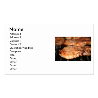 Grilled pork chops on the bbq close up photo business card