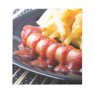 Grilled sausages and fried potato notepad