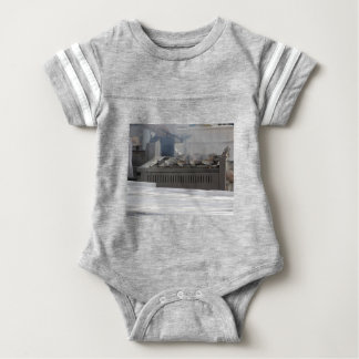 Grilling fish outdoors baby bodysuit