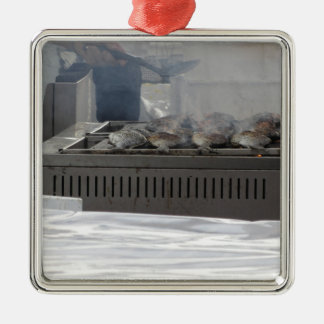 Grilling fish outdoors metal ornament