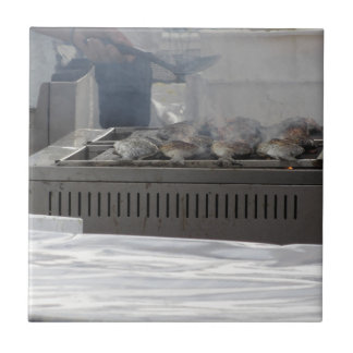 Grilling fish outdoors tile