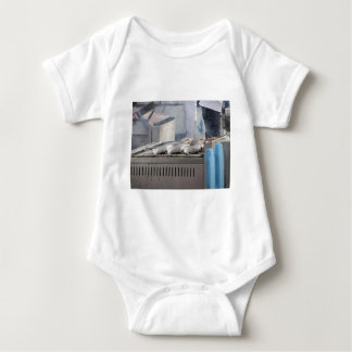 Grilling fish outdoors with smoke emerging baby bodysuit