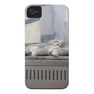 Grilling fish outdoors with smoke emerging Case-Mate iPhone 4 cases