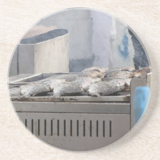 Grilling fish outdoors with smoke emerging coaster