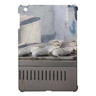 Grilling fish outdoors with smoke emerging iPad mini cover