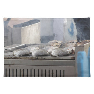 Grilling fish outdoors with smoke emerging placemat