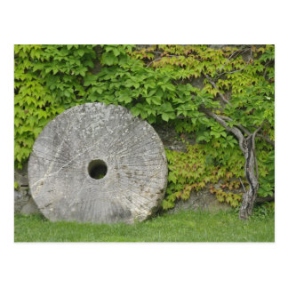 Grinding stone, Castle Banfi in Tuscany region, Postcard