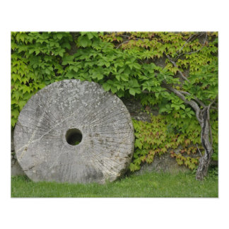 Grinding stone, Castle Banfi in Tuscany region, Poster