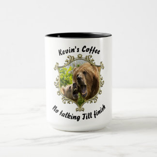 Grizzly bear with her baby in the forest.gold mug