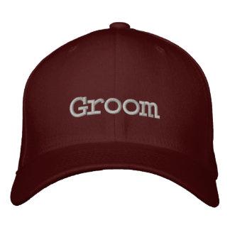 Groom baseball cap in maroon with dark gray font.