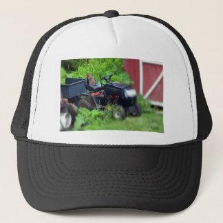 Groundhog on a  Lawn Mower Cap