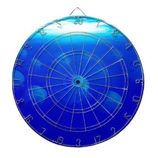 Group blue jellyfish in the Atlantic ocean swiming Dartboard