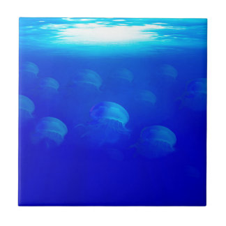 Group blue jellyfish in the Atlantic ocean swiming Tile