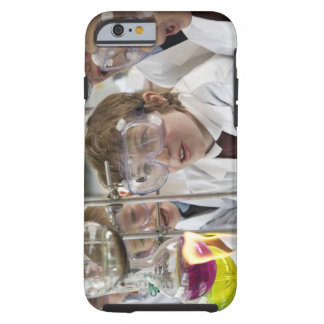 Group of children (9-12) watching experiment in tough iPhone 6 case