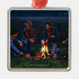 Group of cowboys around campfire Silver-Colored square decoration
