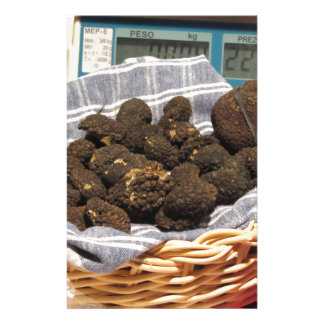 Group of italian expensive black truffles stationery