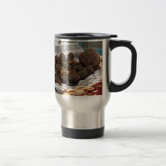 Group of italian expensive black truffles travel mug