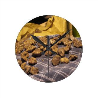 Group of italian expensive white truffles round clock