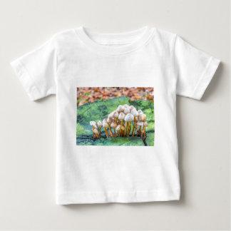 Group of mushrooms on green tree stump baby T-Shirt
