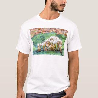 Group of mushrooms on green tree stump T-Shirt