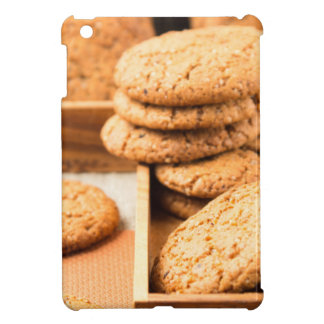 Group of oatmeal cookies on the wooden tray cover for the iPad mini