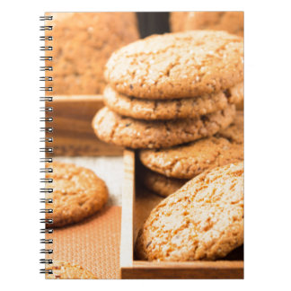 Group of oatmeal cookies on the wooden tray notebook