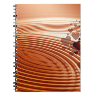 Group of red hearts flowing into the vibrations notebook