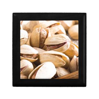 Group of salted pistachios in a small wooden box