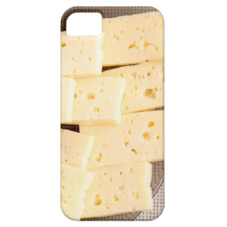 Group slices dry hard yellow cheese on a plate iPhone 5 cases