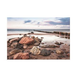 Groyne and stones on the Baltic Sea coast Canvas Print