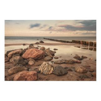 Groyne and stones on the Baltic Sea coast Wood Canvas