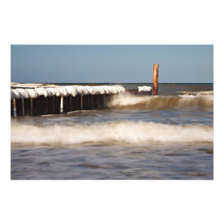 Groynes in winter on shore of the Baltic Sea Photo