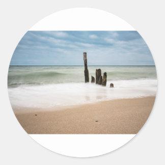Groynes on shore of the Baltic Sea Classic Round Sticker