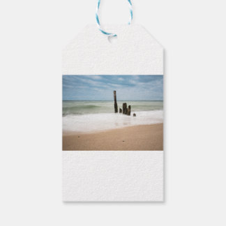 Groynes on shore of the Baltic Sea Gift Tags