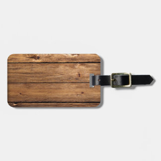 grundgy worn wood background luggage tag