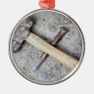 Grungy hammer and chisel metal ornament
