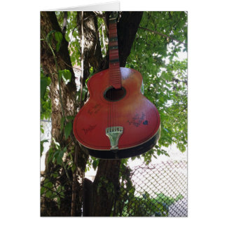 Guitar hanging from a tree Greeting Card, Card