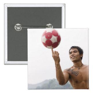 Guy spinning football on finger 15 cm square badge