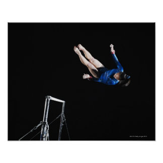 Gymnast (16-17) dismounting uneven bars poster